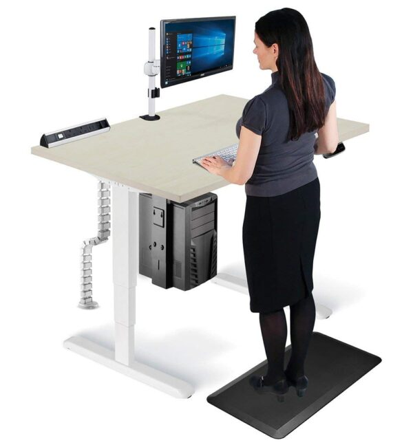 Woman standing at height adjustable desk on an anti-fatigue mat with cable managerment spine and CPU holder