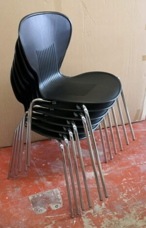 Black Canteen chairs with chrome legs stacked