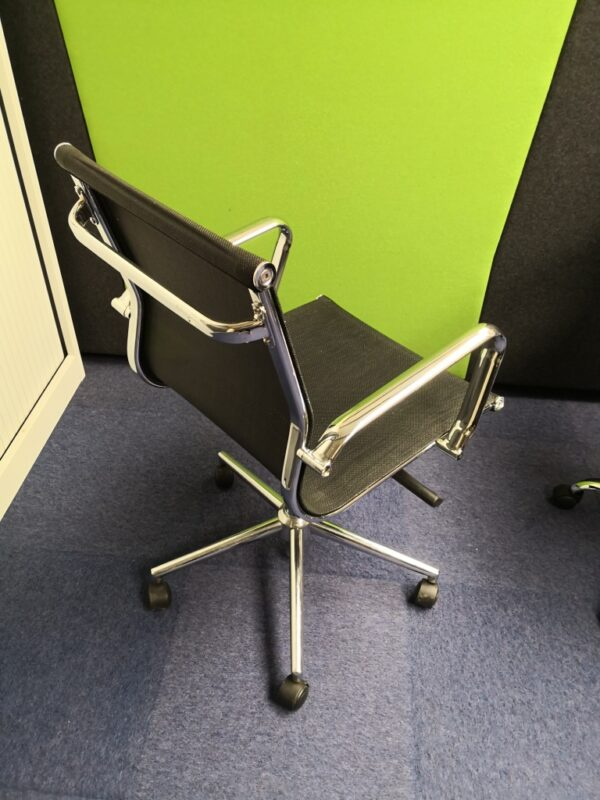 Black mesh executive operator chair with chrome parts