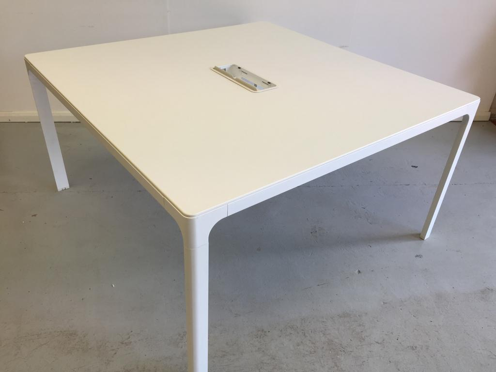 White square meeting table with cable management in the middle