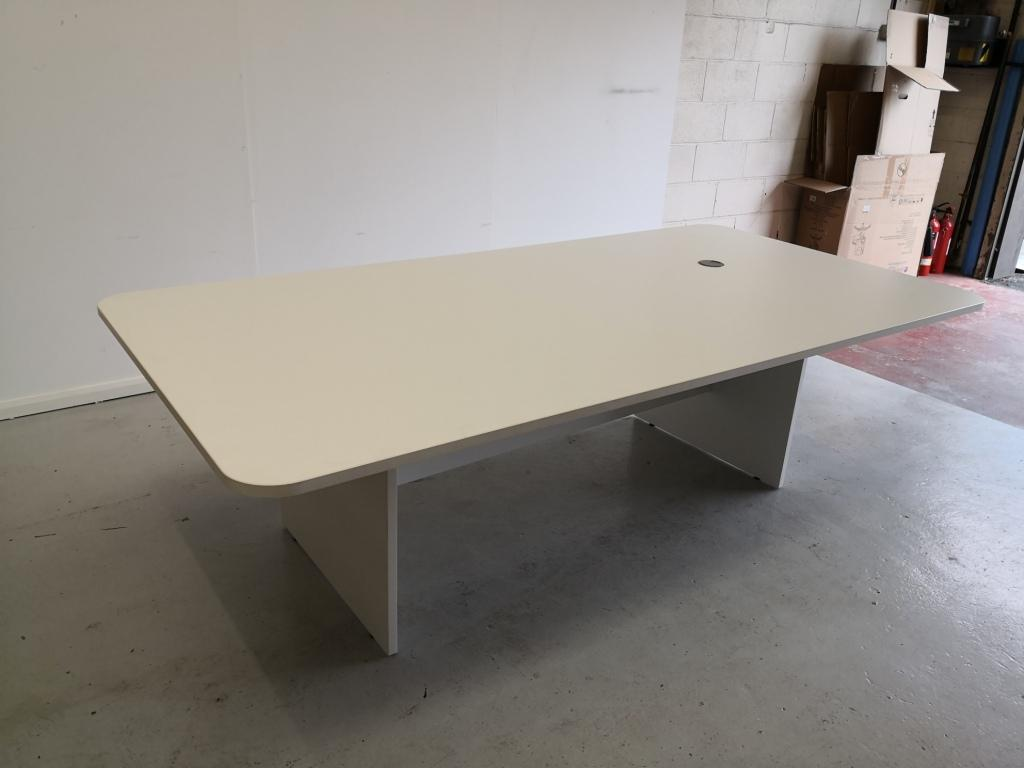 white curved rectangular meeting table with panel end