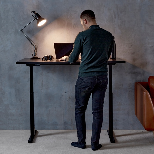 ergo electric desk with man standing
